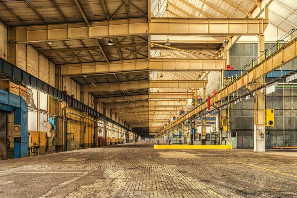 Construcción de naves industriales - Asfaltos y Construcciones Involucra
